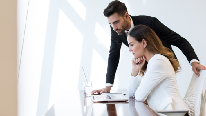 man-and-woman-looking-at-computer